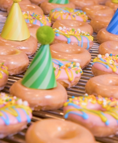 KRISPY KREME® Celebrates Birthday with Special Release: Original Filled Birthday Batter Doughnut and $1 Original Glazed Dozens with Purchase of Any Dozen on Friday, July 19 (Photo: Business Wire)