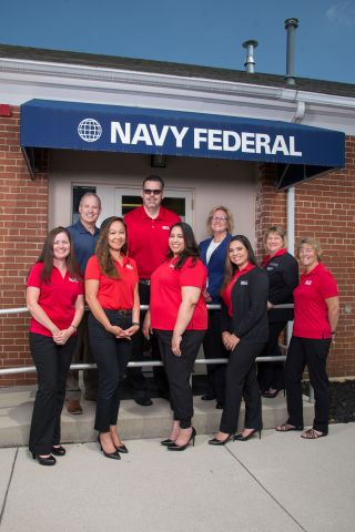 Dietrich Kuhlmann, SVP, Branch Operations, and Debbie Calder, Chief Operating Officer, with the Navy Federal Carlisle Barracks branch team. (Photo: Business Wire)