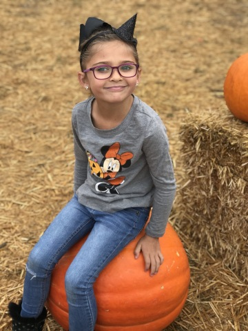 Monroe Le, 6, of San Diego, relaxes on a pumpkin about one month after gene replacement surgery to restore vision. The surgery was performed by a team from The Vision Center at Children's Hospital Los Angeles. Please credit Children's Hospital Los Angeles.