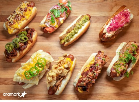 Aramark, the award winning food and hospitality partner of nine Major League Baseball teams, is celebrating National Hot Dog Day, July 17, 2019, with a decadent selection of a dozen loaded hot dogs, sausages and vegan dogs at the ballparks it serves. (Photo: Business Wire)