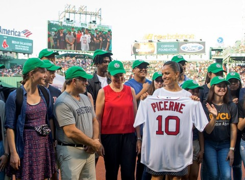 Surrounded by the recent Corvias Foundation college scholarship recipients stands (from left to right) John Picerne, Founder of Corvias Foundation, Maria Montalvo, Executive Director of Corvias Foundation, and Bekah Salwasser, Executive Director of the Red Sox Foundation. Salwasser presented Picerne with a personalized jersey at the July 12th Red Sox game in recognition of Corvias Foundation's 10 years of support and more than $250,000 in donations to the Red Sox Foundation. (Photo Credit: Dan Vaillancourt)