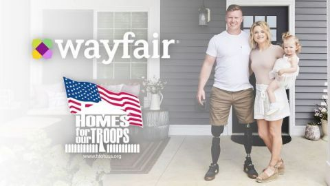 Marine Lance Corporal John Curtin and his family outside their new home built by Homes For Our Troops and furnished by Wayfair. (Photo: Business Wire)