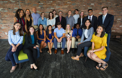 John Picerne (top row, center), Founder of Corvias Foundation, surrounded by recipients of the college scholarship, including both new scholars and recent graduates. (Photo Credit: Dan Vaillancourt)