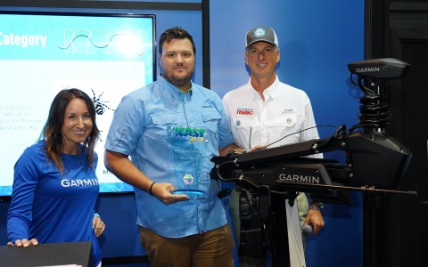 Garmin prevails at the fishing industry's most prestigious tradeshow, winning the 2019 ICAST Best of Show title with its new Force trolling motor. Left to right: Carly Hysell, Garmin PR Manager, David Dunn, Garmin Director of Marine Sales; and Glenn Hughes, ASA President. (Photo: Business Wire)