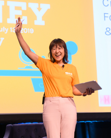 VIPKid Founder and CEO Cindy Mi waves to the audience of 500 online English teachers. Photo Credit: VIPKid/Grant Miller Photography
