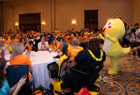 Teachers cheer as Dino, VIPKid's mascot, enters the ballroom. Photo Credit: VIPKid/Grant Miller Photography