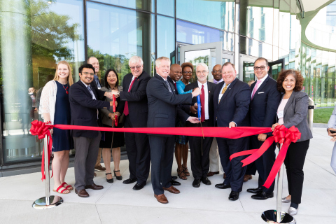 """American Campus Communities and the University of Illinois at Chicago celebrate the grand opening of the partnership's newest on-campus student community, the Academic and Residential Complex. ACC EVP of Public-Private Transactions James Wilhelm joins UIC Chancellor Michael Amiridis, UIC President Timothy Kileen, UIC Board of Trustees representatives and city of Chicago and Illinois state representatives for the community's ribbon cutting ceremony. Pictured (from left to right): Allison Bondele, Student President UIC Campus Housing Resident Hall Association; Byron Sigcho-Lopez, Alderman City of Chicago 25th Ward; Bill Cunningham, State Senator 18th District; Theresa Mah, State Representative 2nd District; Michael Amiridis, Chancellor, University of Illinois at Chicago; Jamie Wilhelm, ACC EVP of Public-Private Transactions; Emanuel """"Chris"""" Welch, State Representative 7th District; Camille Lilly, State Representative 78th District; Timothy Killeen, President University of Illinois; William Q. Davis, State Representative 30th District; Patrick Daley Thompson, Alderman, City of Chicago 11th Ward; Ramon Cepeda, Trustee, University of Illinois and Elizabeth Hernandez, State Representative, Illinois 24th District. (Photo: Business Wire)"""