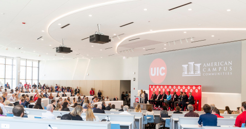 American Campus Communities and the University of Illinois at Chicago celebrate the grand opening of the partnership's newest on-campus student community, the Academic and Residential Complex. ACC EVP of Public-Private Transactions James Wilhelm joins UIC Chancellor Michael Amiridis, UIC President Timothy Kileen, UIC Board of Trustees representatives and city of Chicago and Illinois state representatives for the community's ribbon cutting ceremony. (Photo: Business Wire)