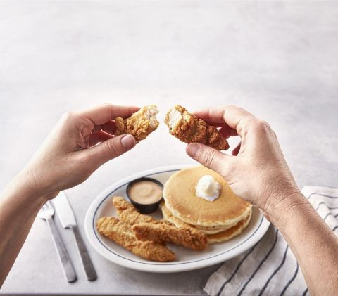 New Crispy Chicken & Pancakes, which combines three of IHOP's hot, fluffy World Famous Buttermilk pancakes with four breaded and seasoned chicken breast strips, is available for just $6.99* for a limited time. (Photo: Business Wire)