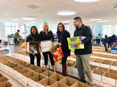 Carrington's Vylla team raised $10,000 and filled an impressive 520 boxes for troops serving overseas. (Photo: Business Wire)