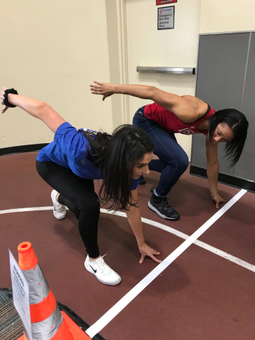 Sylvia Hoffman, 2018 finalist, The Next Olympic Hopeful, and now a member of Team USA Bobsled, demonstrates the sprint position to an athlete during recent 24 Hour Fitness in-club tryouts (Photo: Business Wire)