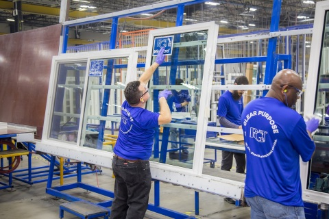 Employees inside one of PGT Innovations' manufacturing facilities (Photo: Business Wire)