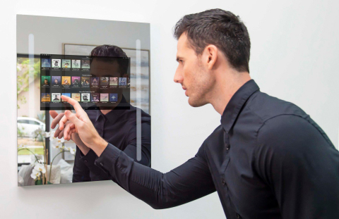 Introducing our Capstone Connected Home Smart Mirror. A voice controlled, touch screen mirror. (Photo: Business Wire)