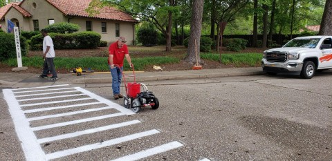 The Fort Bragg housing partnership with Corvias and the U.S. Army includes community care, such as crosswalk striping, paving, and cleaning. (Photo: Business Wire)