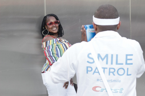 A Cincinnati Music Festival attendee smiles with confidence, as the Crest Smile Patrol takes Polaroid photos of guests all weekend long. (Photo: Business Wire)