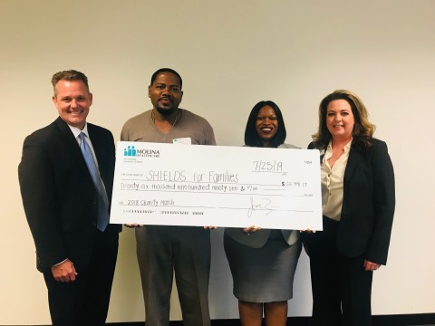 Molina Healthcare of California proudly presents $26,990 donation to SHIELDS for Families, a local nonprofit, to support the organization's commitment to helping individuals and families in need. (Left to right) President of Molina Healthcare of California, John Kotal; Development Specialist at SHIELDS for Families, Marcus Holcombe; Training Manager and Clinical Training Program Coordinator, Veronica Clanton-Higgins; Vice President of Network Strategy and Services for Molina Healthcare, Kimberly Sweers. (Photo: Business Wire)
