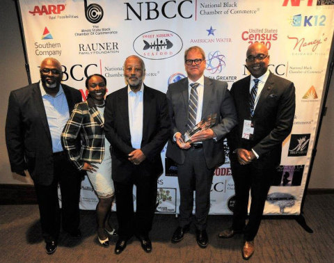 (L-R) Larry Ivory, President/CEO of the Illinois Black Chamber of Commerce; Rhonda Carter Adams, Illinois American Water Diversity Lead; Harry C. Alford, President/CEO of the National Black Chamber of Commerce; Bruce Hauk, Illinois American Water President; and James F. Claybourne, Jr., Former Illinois State Senator. (Photo: Business Wire)