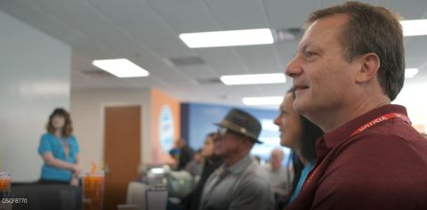 Parents look on as Desert Financial employees talk about their roles at the credit union. (Photo: Business Wire)