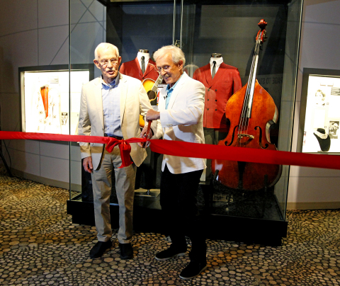 Tom and Dick Smothers cut the ribbon on the new Smothers Brothers exhibit at The National Comedy Center in Jamestown, N.Y. on July 29, 2019. (Photo: Business Wire)