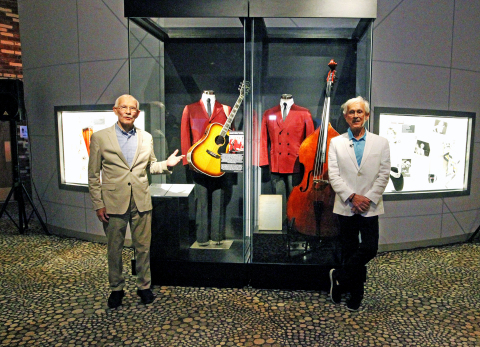 Tom and Dick Smothers stand next to the new Smothers Brothers exhibit at The National Comedy Center in Jamestown, N.Y. on July 29, 2019. (Photo: Business Wire)