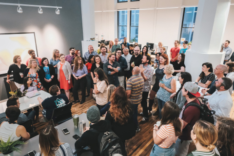 CEO Toohey shares news with team at 2e Creative (Photo: Business Wire)