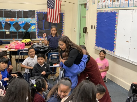 Michelle Marquez connecting with a young listener (Photo: Business Wire)