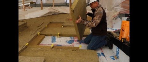 Cascadia Clips installed on sloped roof, followed by insulation install. (Photo: Business Wire)