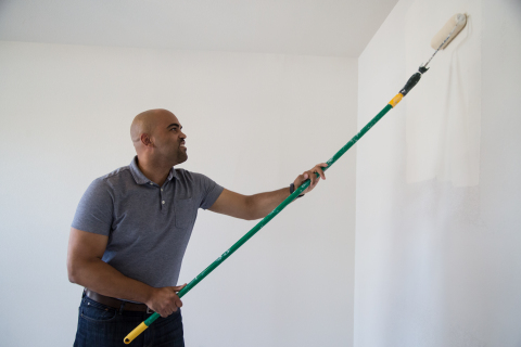 Congressman Colin Allred seen painting one of the walls during a homebuild with the Habitat for Humanity of Greater Garland last Wednesday. The home tour and build was to recognize contributions to affordable housing initiatives for the area. (Photo: Business Wire)