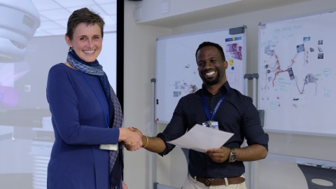 Dr. Jeannette Parkes, Head of the division of Clinical and Radiation Oncology at Groote Schuur Hospital and the University of Cape Town delivers Global Access to Cancer Care Training Completion Certificate to Kuhn Pemberton.