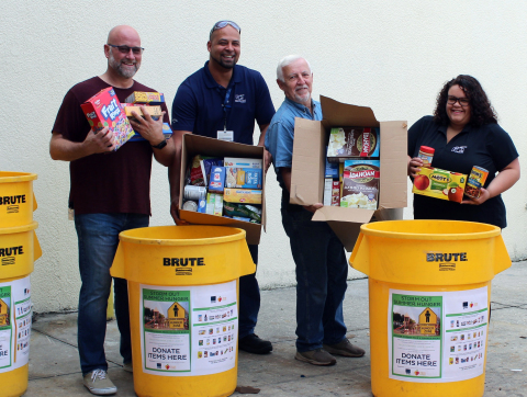 Bryan Lingle, Jonathan Miro, Jim Heise and Yessenia Munoz from PGT Innovations' Venice facility deliver their location's collected items to All Faith's Food Bank in Sarasota, Florida. (Photo: Business Wire)