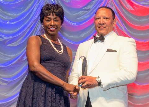 Rynthia Rost accepts the Charles B. Collins Distinguished Trustee Award from National Urban League President and CEO Marc H. Morial. Photo courtesy of the National Urban League (Photo: Business Wire)