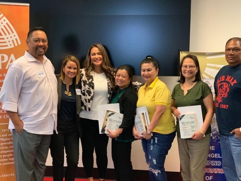 Michelle Marquez (3rd from left) with participants from Financial Literacy workshop (Photo: Business Wire)