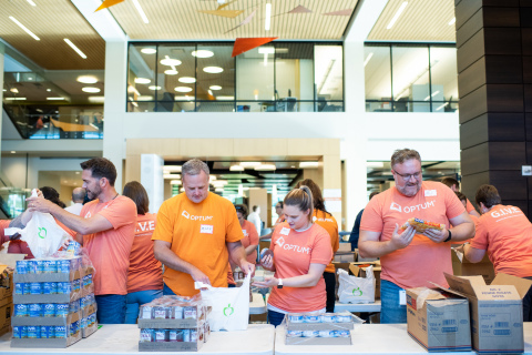 Nearly 500 Optum employee volunteers in Eden Prairie, Minn., teamed up with The Sheridan Story, a local nonprofit committed to fighting child hunger, to prepare meals and backpacks as part of Optum's second-annual global giving day. The elaborate operation used conveyer belts and trucks to load and deliver 40,000 backpacks full of healthy food – the equivalent of 150,000 meals – to children in need (Photo: Dean Riggott).