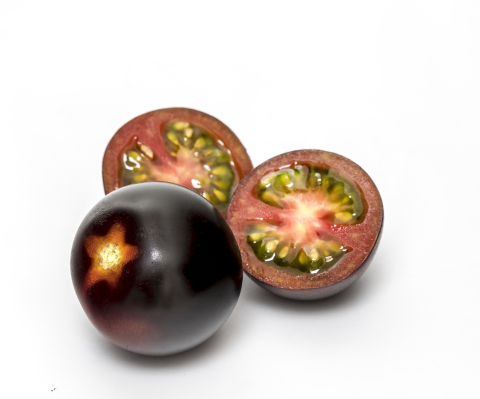 The new purple-skinned YOOM™ cocktail tomato was developed through a natural selection breeding program by Syngenta Vegetable Seeds' tomato specialists. (Photo: Syngenta)