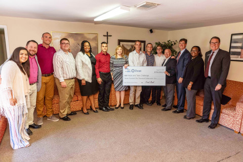 (L-R) Cesiah Colston of Adult and Teen Challenge; Jason Colston, Executive Director at Adult and Teen Challenge; unnamed resident; unnamed resident; Trisha Bradley of Frost Bank; unnamed resident; Donna Normandin of Frost Bank; three unnamed residents; Congressman Kevin Brady, R-TX; Greg Hettrick of the Federal Home Loan Bank of Dallas; Erika Jones of Frost Bank; and Eric Haar of the Federal Home Loan Bank of Dallas. (Photo: Business Wire)