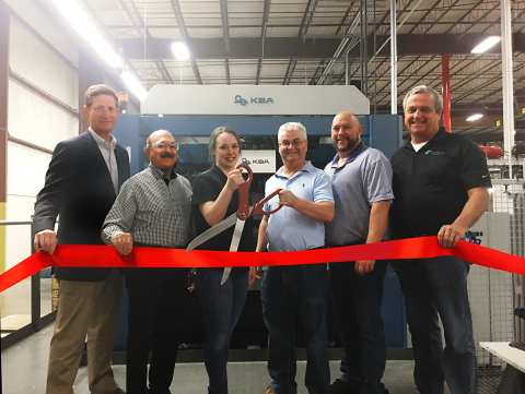 The team at PaperWorks celebrates a special ribbon-cutting event to mark the official start of the company's latest capital equipment investments: a Koenig & Bauer Rapida 145 57-inch seven-color press along with two new Koenig & Bauer-Iberica 144K die cutters at the Baldwinsville, NY facility. Left to right: Zack Hall, Vice President Packaging Operations; Tony Foti, Director, Project Management; Shelby Jacobsen, Southside Production Manager; Don Gray, Director of Engineering; Jason Barber, Litho Process Engineer; and Bill Lennox, Vice President & General Manager, Northeast Packaging Operations. (Photo: Business Wire)