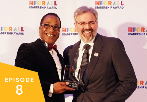 "Great Place to Work CEO Michael C. Bush (left) recognizes Crowe LLP's Chief Innovation & Strategy Officer Derek Bang with a ""For All"" Leadership Award at the 2019 Great Place to Work For All Summit. (Photo: Business Wire)"