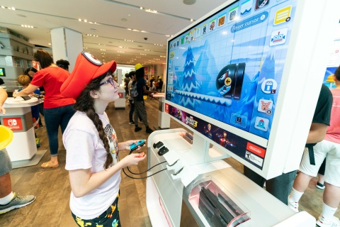 In this photo provided by Nintendo of America, Emily S., age 12, celebrates the back-to-school season with the Super Mario Maker 2 game during a special event at the Nintendo NY store in Rockefeller Plaza on Aug. 18, 2019. Super Mario Maker 2 is now available for the Nintendo Switch system. (Photo: Business Wire)