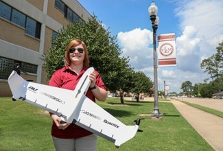 University of Louisiana Monroe UAS major Stephanie Robinson holds the Quantix drone, donated by AeroVironment to the school's Precision Agriculture and UAS Research Center. (Photo: The University of Louisiana, Monroe)