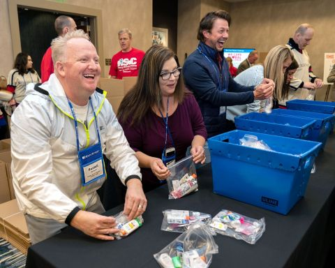 "Team Schein Members begin assembling ""comfort kits"" for people fighting cancer as part of Henry Schein, Inc.'s second annual We Care Global Challenge. (Photo: Business Wire)"
