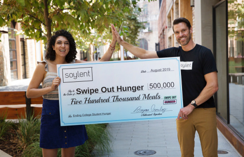 Soylent CEO Brian Crowley with Swipe Out Hunger Founder + CEO Rachel Sumekh (Photo: Business Wire)