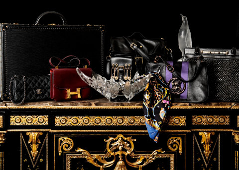 Among the vintage luxury goods featured at Abell Auction Co.'s Sept. 10 live and online sale are (left to right) this Louis Vuitton Alzer 55 noir hard suitcase, Chanel black quilted east west flap bag, Lalique molded glass jardinière, Versace Versus safety pin bag, Hermes Pierres d'Orient et d'Occident scarf, Gucci by Tom Ford Serpent messenger bag, Lalique penguin and Valentino Garavani black Demetra handbag. (Photo: Business Wire)