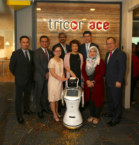 Caption of Photo attached: Unveiling of Tricor Group's new Shared Services Centre (SSC) named Tricor ace; Group CEO Lennard Yong (third from right), Group CFO & COO Wendy Wang (fourth from right), with special invited guests Pauline Goh, Director of Alliances, InvestKL (third from left) and Nik Izuddin Nik Mohd Yusof, Head of Global Business Services & Industry Development, MDEC (far left), Alia Sutarji, Lead Content & Solutioning, MDEC (second from right). Yeap Kok Leong, CEO & Managing Director Tricor Malaysia (far right), Joe Wan, CEO Tricor Hong Kong (second from left) and Prasad KNVS, Head of SSC (fourth from left) completes the group photograph. (Photo: Business Wire)