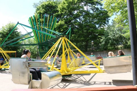 (Image) Poison Ivy Toxic Twister features a wicked twist on a family classic. Individual pods spin counterclockwise, gluing riders to the sides with centrifugal force, while the entire ride swirls in the opposite direction to create a scrambling experience. (Photo: Six Flags)