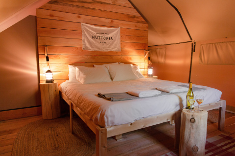 Huttopia's Trappeur Duo is a romantic wood and canvas tent that features a large terrace, giving couples the opportunity to experience nature like never before. (Photo: Business Wire)