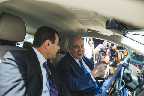 Intel Senior Vice President and Mobileye CEO Prof. Amnon Shashua (left) shows Israeli Prime Minister Benjamin Netanyahu the technology behind one of Mobileye's autonomous vehicles in Jerusalem on Tuesday, Aug. 27, 2019. Shashua and Netanyahu broke ground on Mobileye's new global development center at a cornerstone laying ceremony before getting behind the wheel. (Credit: Victor Levi/Mobileye)