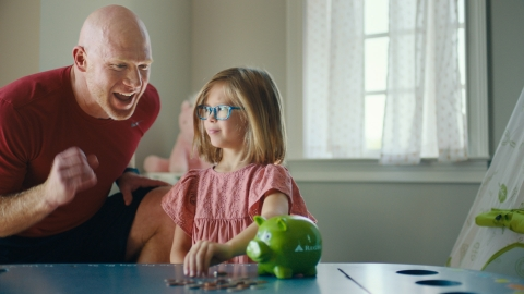 """In a new Regions Bank series of commercials called """"Greatness in the Grind,"""" Strength and Conditioning Coach Scott Cochran moves from encouraging players to helping everyday people do their financial best. (Photo: Business Wire)"""