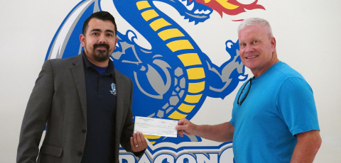 L-R Mario Mondragón, Principal of Medrano Elementary School in Dallas, accepts $50,000 food pantry donation from Vehicle Safety Lawyer Todd Tracy. (Photo: Business Wire)