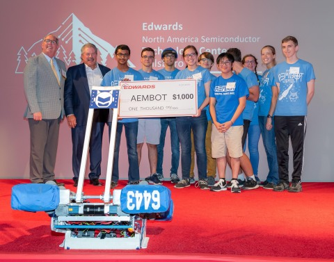 Hillsboro Mayor, Steve Callaway, and Edwards Vacuum U.S. President, Scott Balaguer, present check to AEMBOT robotics team (Liberty High School) during Edwards opening event. (Photo: Business Wire)