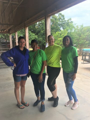 Pillar Income Asset Management/Regis Property Management employees volunteer at Single Parent Advocate's Back To School Supplies Party at Circle R Ranch in Flower Mound, Texas (Photo: Business Wire)
